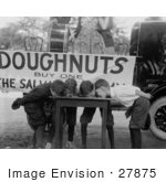#27875 Stock Photo of Four Boys With Their Hands Behind Their Backs, Bending Over And Eating Donuts During A Doughnut Eating Contest On May 5th 1922 by JVPD