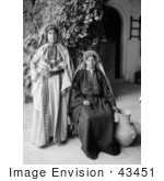 #43451 Rf Stock Photo Of Two Young Ramallah Women In Black And White One Sitting One Standing
