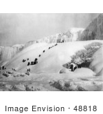 #48818 Royalty-Free Stock Photo Of People Climbing A Snowy Hill To The Icy Niagara Falls