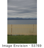 #53769 Royalty-Free Stock Photo Of A Fence By A Beach