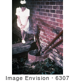 #6307 Picture Of A Nurse Standing Near Sewage Pipes Outside Of An Infectious Disease Hospital In Johannesburg South Africa