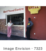 #7323 Picture Of A Man And Woman Standing Outside Of A Shell Gas Station Where Two People Became Ill With The Marburg Virus