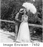 #7452 Stock Photo of a Man and Woman Kissing Under a Parasol by JVPD
