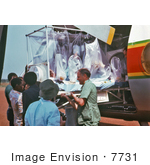 #7731 Picture Of A Plastic Ebola Virus Isolator Being Loaded Into A Plane