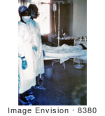 #8380 Picture Of Two Nurses Standing In Front Of A Patient Who Is Infected With The Ebola Virus - 1976