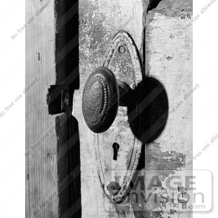 Stock Oval Door Knob and Skeleton Key Hold on a Door at the