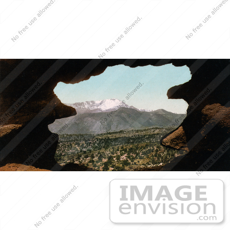 #40827 Stock Photo of a View Of Pikes Peak Framed By Rocks As Seen From Gateway Colorado by JVPD