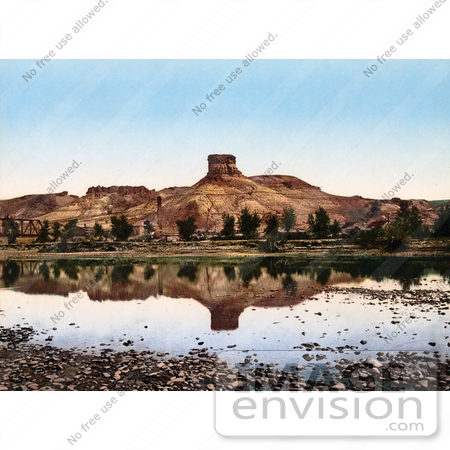 #40832 Stock Photo of a Factory At The Base Of A Butte Reflecting In Green River, Utah by JVPD