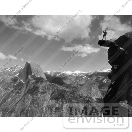 #41171 Stock Photo Of A Lone Man Standing On An Overhanging Rock Cliff At Glacier Point, With A View Of Half Dome And The Valley Of Yosemite National Park, California by JVPD