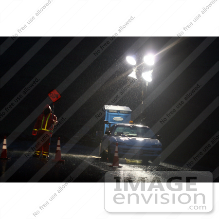 #802 Photography of a Road Construction Flagger at Night in the Rain by Kenny Adams