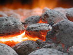 Charcoal Briquettes Burning in a BBQ Grill