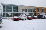 Cars Parked on a Snow Covered Parking Lot Infront of the Jackson County Library