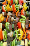 Veggies and Meat on Skewers on a BBQ