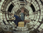 Three women working inside circular structure of the fuselage