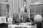 Gerald Ford Working at His Desk, Smoking a Pipe