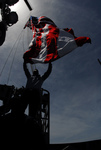 Picture of a Sailor Hoisting Flag