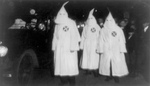 Three KKK Members in a Parade