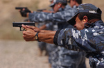 Iraqi Police Shooting Weapons