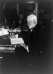 Andrew Carnegie Reading at a Desk