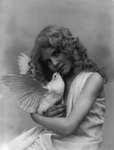 Girl Holding a White Dove