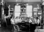 Female Students Reading in a Library