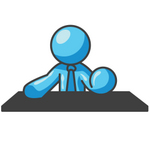 Clip Art Graphic of a Sky Blue Guy Character Behind a Desk